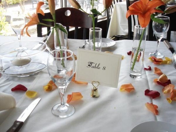 Table place setting with flower petals