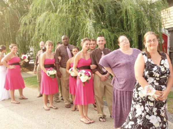 People in wedding waiting outside