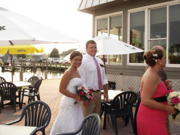 Bride and groom on patio at Brew River