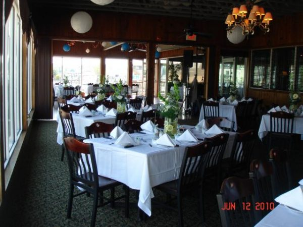 Restaurant interior with white table clothes