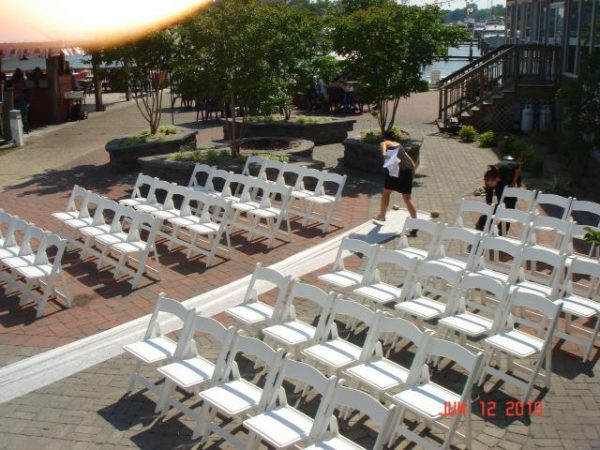Outdoor wedding seating white chairs