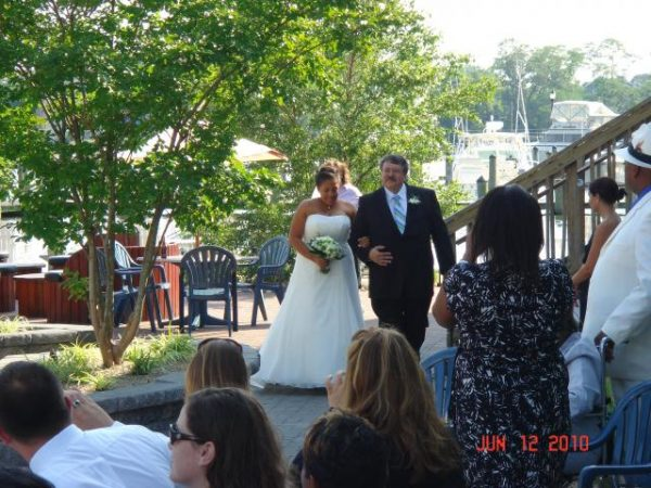 bride and groom walking into restaurant