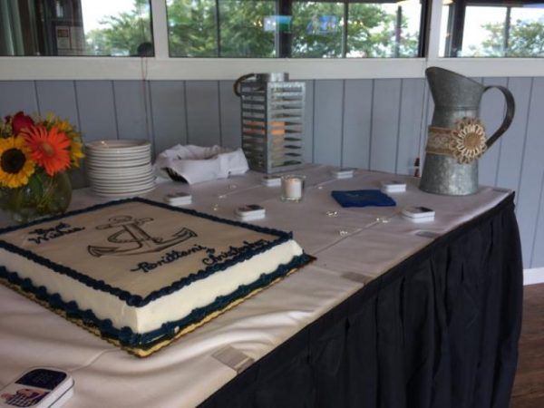 Table with blue and white cake