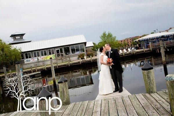 bridge and groom kissing on dock